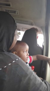 My neighbour in the car going to Accra from Aflao border. Joel is seated up front