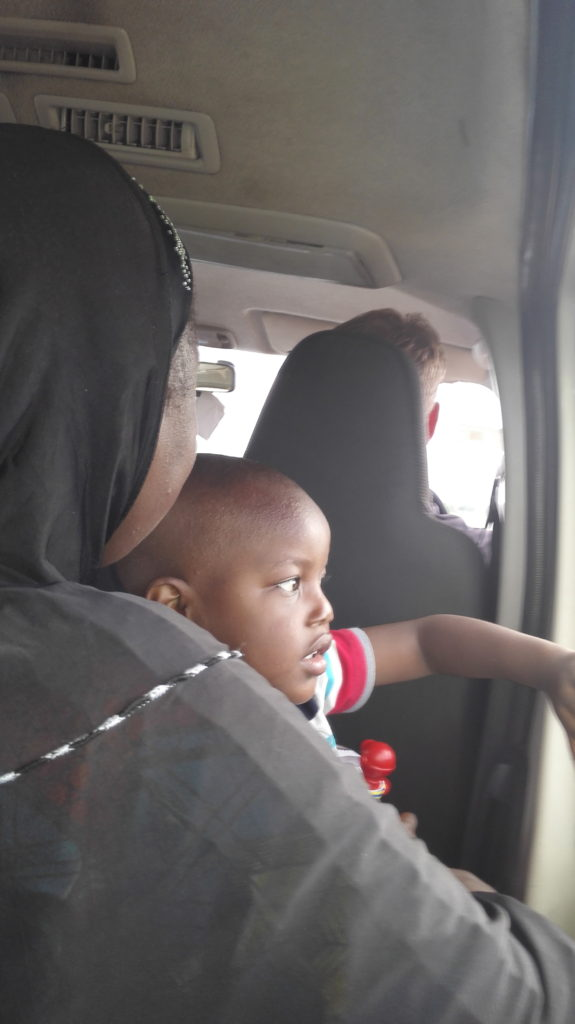 My neighbour in the car going to Accra from Aflao border
